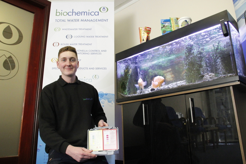 Warehouse Assistant Apprentice, Tom Hamilton with the Scaling Up Apprentices fish tank